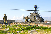 Utility Helicopters Framed Prints - U.s. Army Soldiers Prepare To Fuel An Framed Print by Stocktrek Images