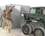 Us Open Framed Prints - U.s. Army Soldiers Use A Bobcat S150 Framed Print by Stocktrek Images