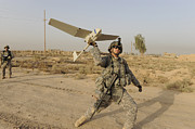 Baghdad Framed Prints - U.s. Army Specialist Launches An Rq-11 Framed Print by Stocktrek Images