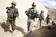 Foot Patrol Photos - U.s. Army Troops Lead A Patrol by Stocktrek Images