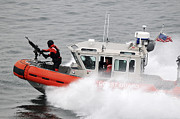 Two Waves Photos - U.s. Coast Guardsmen Aboard A Security by Stocktrek Images