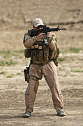 Contractor Prints - U.s. Contractor Firing A M4 Carbine Print by Terry Moore
