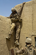 Ledge Photos - U.s. Marine Climbs Down From An by Stocktrek Images