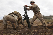 Bending Prints - U.s. Marine Drops A Mortar Round Print by Stocktrek Images