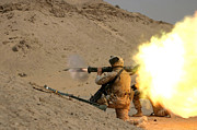 Kneeling Prints - U.s. Marine Fires An M136 At4 Light Print by Stocktrek Images