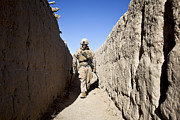Narrow Perspective Framed Prints - U.s. Marine Sweeps An Alleyway Framed Print by Stocktrek Images