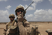 Deployment Framed Prints - U.s. Marine Uses A Radio In Djibouti Framed Print by Stocktrek Images