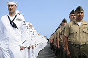 Uss Ronald Reagan Prints - U.s. Marines And Sailors Stand Print by Stocktrek Images
