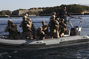Assault Rifles Photo Framed Prints - U.s. Marines Approach A Suspect Vessel Framed Print by Stocktrek Images