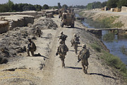 Dirt Roads Photos - U.s. Marines Conduct A Security Patrol by Stocktrek Images