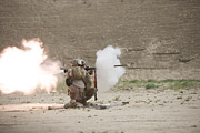 Shoulder-launched Posters - U.s. Marines Fire A Rpg-7 Grenade Poster by Terry Moore