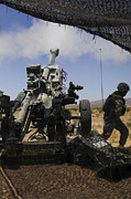 Artillery Framed Prints - U.s. Marines Fire An M777 Howitzer Framed Print by Stocktrek Images