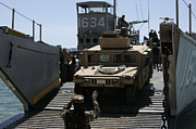 M1114 Framed Prints - U.s. Marines Load An M1114 Humvee Onto Framed Print by Stocktrek Images