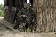 Bamboo House Photos - U.s. Marines Prepare To Enter A House by Stocktrek Images