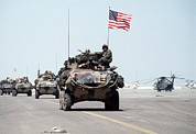 Desert Storm Prints - Us Marines Roll Into Kuwait Print by Everett
