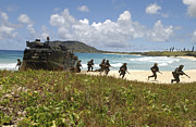 Beachhead Posters - U.s. Marines Run Out Of An Amphibious Poster by Stocktrek Images