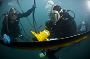 Diving Helmet Photo Posters - U.s. Navy Diver Instructs A Barbados Poster by Stocktrek Images