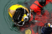 Submerge Photos - U.s. Navy Diver Is Lowered by Stocktrek Images