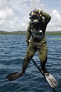 Diving Suit Prints - U.s. Navy Diver Jumps Off A Dive Print by Stocktrek Images