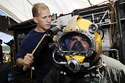 Diving Helmet Prints - U.s. Navy Diver Performs A Leak Check Print by Stocktrek Images