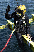 Swimsuit Photography Prints - U.s. Navy Diver Signals An Ok Sign Print by Stocktrek Images