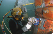 Submerge Photos - U.s. Navy Diver Uses A Grinder To File by Stocktrek Images