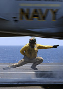 Gesturing Posters - U.s. Navy Lieutenant Launches An Fa-18 Poster by Stocktrek Images