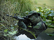 Assault Prints - U.s. Navy Seal Crosses Through A Stream Print by Tom Weber