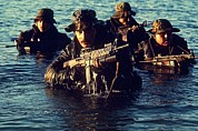 Rifles Framed Prints - Us Navy Seal Team Emerges From Water Framed Print by Everett