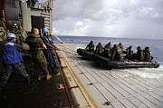 Inflatable Photos - U.s. Sailors And Marines Recover by Stocktrek Images