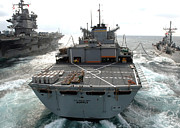 Usns Supply Posters - Usns Supply Conducts A Replenishment Poster by Stocktrek Images