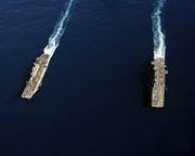 Aircraft Carrier Prints - Uss Iwo Jima Steams Alongside Uss Print by Stocktrek Images