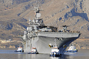 Boats In The Harbor Prints - Uss Kearsarge Arrives In Souda Bay Print by Stocktrek Images