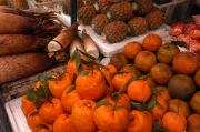 Pineapples Photos - Variety Of Fruit At A Vendors Stall by Anne Keiser