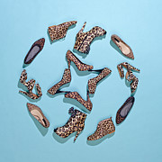 Leopard Print Framed Prints - Various Leopard Print Shoes Arranged In A Pattern Framed Print by Larry Washburn