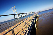 Metal Pier Prints - Vasco da Gama Bridge Print by Carlos Caetano