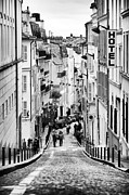 Black And White Paris Posters - Vers le haut de La Rue Poster by John Rizzuto