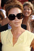 Teased Hair Prints - Victoria Beckham At Arrivals Print by Everett