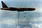 B-52 Posters - Vietnam War. A B-52 Drops Christmas Poster by Everett
