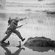 Candid Portraits Photo Prints - Vietnam War. A Us Marine Rifleman Leaps Print by Everett