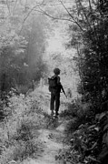 Candid Portraits Prints - Vietnam War. A Us Marine Walking Point Print by Everett