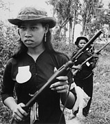 Insurgency Prints - Vietnam War. Girl Volunteers With Fine Print by Everett