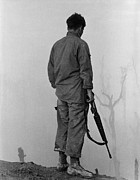 Candid Portraits Photo Prints - Vietnam War. Us Infantryman Looks Print by Everett