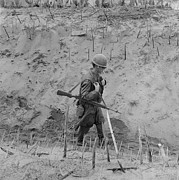 Candid Portraits Photo Prints - Vietnam War. Us Marine Walks Print by Everett