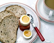 Egg-cup Photos - View Of A Healthy Breakfast Of Egg, Bread And Tea by Erika Craddock