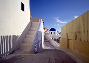 Oia Prints - View of city of Oia on Santorini Print by Cliff Wassmann
