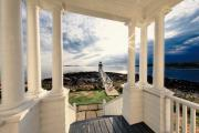 Dramatic Light Posters - View of the Marshall Point Lighthouse from the Keepers House Poster by George Oze