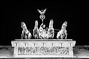 viktoria with quadriga on top of the Brandenburg gate at night Berlin Germany Print by Joe Fox