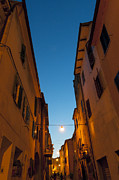 Narrow Perspective Framed Prints - Village Street At Night Framed Print by Stuart McCall