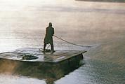 Villager On Raft Crosses Lake Phewa Tal Print by Gordon Wiltsie